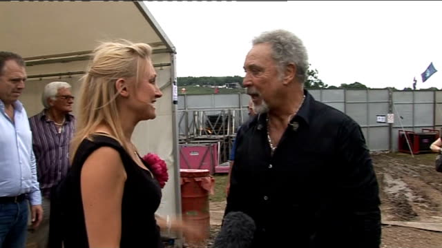 Glastonbury Festival 2009 Interviews Tom Jones along as greeted by ITN reporter and kisses her Tom Jones interview SOT On the performance he has just...