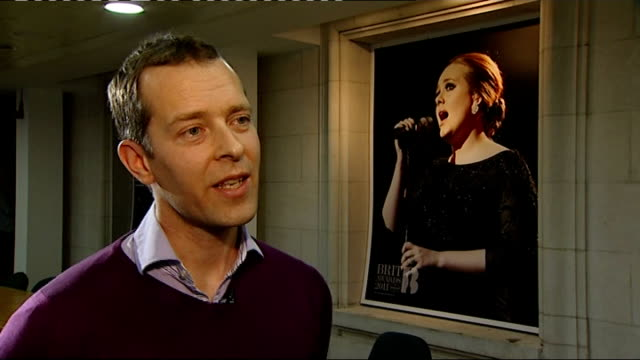 Grammy Awards 2012 Adele wins six awards ENGLAND London Jeff Taylor along corridor with reporter Jeff Taylor interview SOT