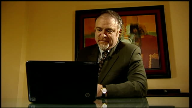 Grammy Awards 2012 Adele wins six awards INT Dr Steven Zeitels watching performance on laptop computer SOT