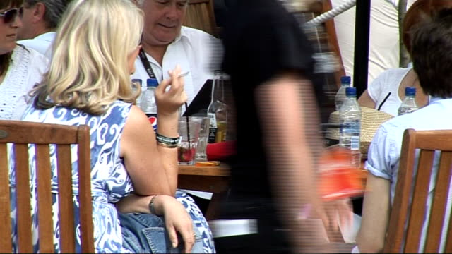 hard rock calling festival in hyde park celebrity interviews various of refreshment stands and people drinking at tables / two men drinking beer /... - hard rock cafe stock videos & royalty-free footage