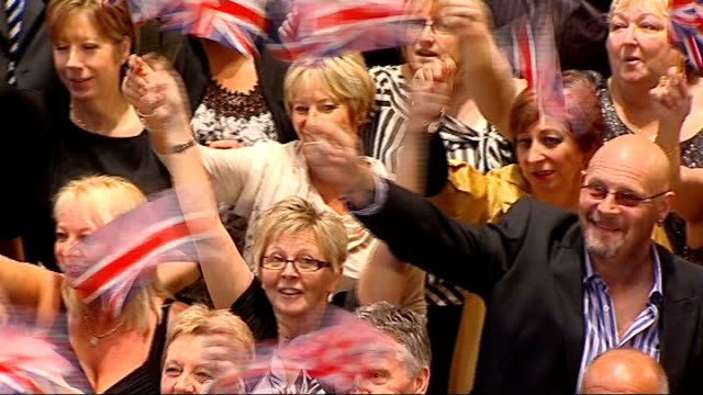 music heard during the following shots sot * * crowd of lottery winners waving union flags at party to celebrate 15th anniversary of national lottery - anniversary stock videos & royalty-free footage