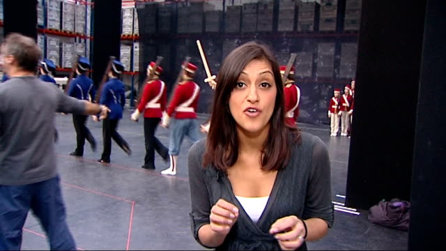 ** music heard sot ** dress rehearsal of toy soldiers' dance reporter to camera cutaway dancers in rat costumes dancer being fitted with rat costume... - the nutcracker named work stock videos & royalty-free footage