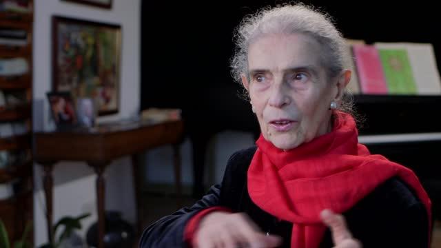 vídeos y material grabado en eventos de stock de holocaust memorial day: piano teacher nelly ben-or on her memories of auschwitz; england: int close shot of front cover of nelly ben-or... - war and conflict