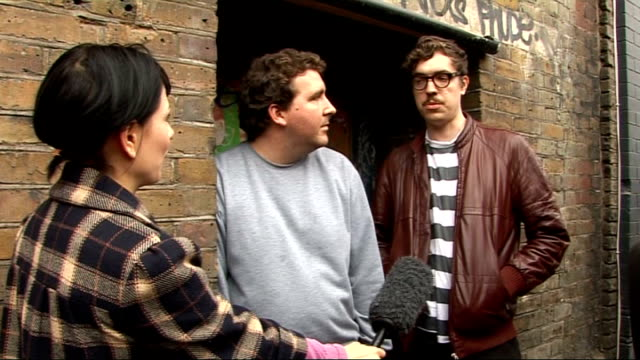 hot chip interview; england: london: ext joe goddard and felix martin interview sot - on curating a hidden gig for homeless charity crisis / why they... - hiding stock videos & royalty-free footage