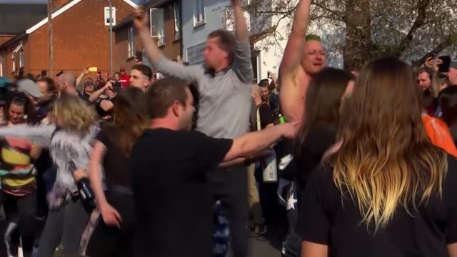 hundreds of fans turn out for funeral of prodigy frontman keith flint; england: essex: bocking: ext raving mourners dancing various of people dancing... - mourner stock videos & royalty-free footage