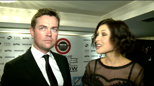 music industry trust awards ceremony: arrivals and interviews; stephen mulhern and emma willis interview sot / kimberley walsh posing in red floor... - length stock videos & royalty-free footage