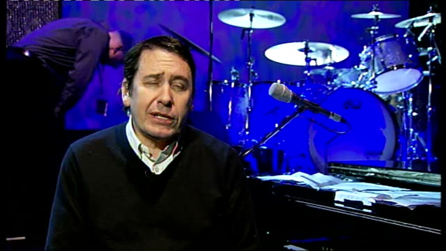 interview jools holland; england: london: royal albert hall: int jools holland interview sot - says chris difford is appearing with him tonight /... - jools holland stock-videos und b-roll-filmmaterial