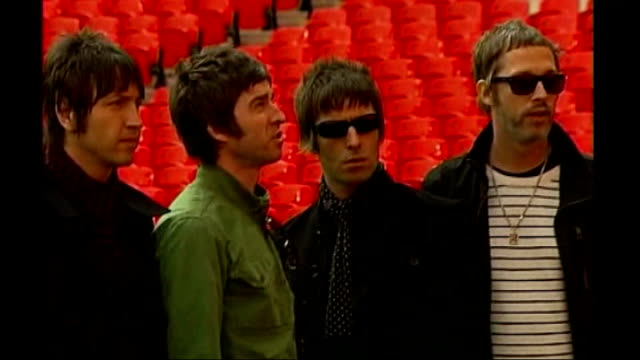interview with noel gallagher; r16100803 wembley stadium: ext oasis posing for photocall - オアシス点の映像素材/bロール