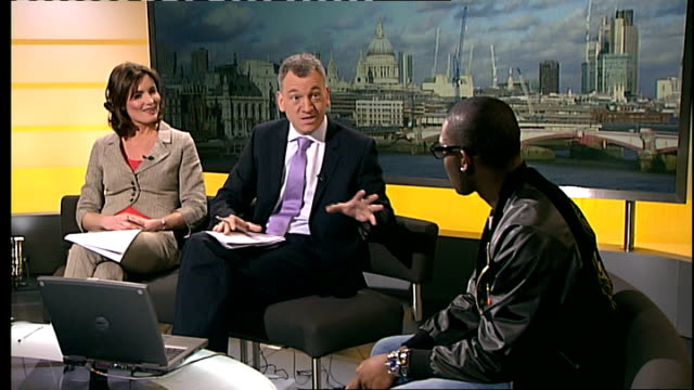 interview with tinie tempah; t26021043 reporter asking tinie tempah to return when he has lots of bling sot - bling bling stock-videos und b-roll-filmmaterial