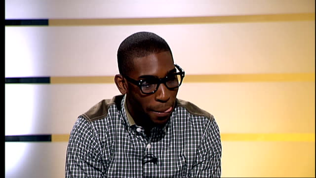 interview with tinie tempah; tinie tempah live studio interview sot - on not having any bling on him - on advice he has for young people who want to... - bling bling stock-videos und b-roll-filmmaterial