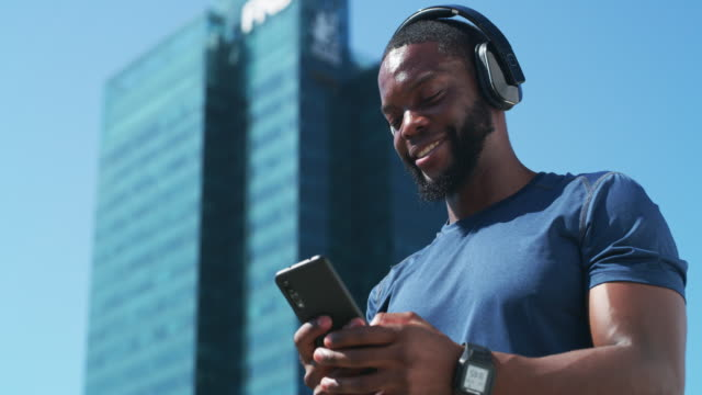 music is his main source of motivation - listening stock videos & royalty-free footage
