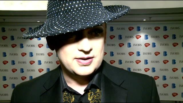 ivor novello awards 2012: celebrity interviews; england: london: grosvenor house: int **beware flash photography** boy george speaking to press /... - クラウディア ウィンクルマン点の映像素材/bロール