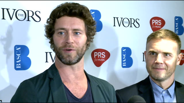 ivor novello awards 2012 celebrity interviews take that posing with awards take that speaking to press sot on winning / all sharing their songwriting... - take that stock videos and b-roll footage