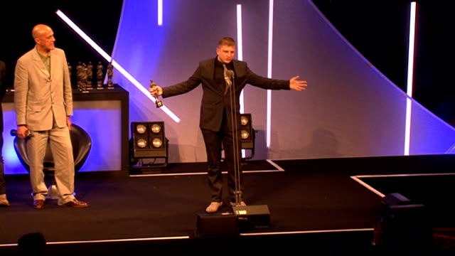 ivor novello awards; england: london: grosvenor house: int seq plan b collecting ivor novello awards on stage long shot plan b on stage with sir... - ben elton stock videos & royalty-free footage