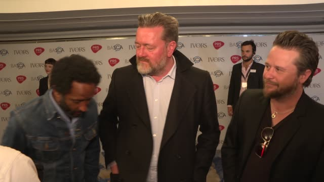 Ivor Novello awards Red carpet arrivals and winners' room ENGLAND London PHOTOGRAPHY*** Red carpet Elbow interview SOT / **Warning contains...