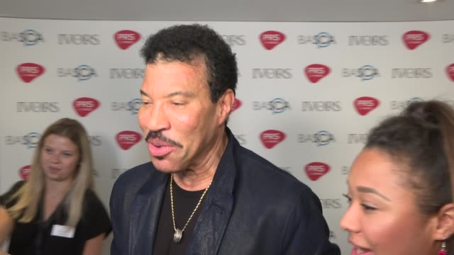 ivor novello awards: red carpet arrivals and winners' room; england: london: int winners' room: lionel ritchie interview sot and cutaways - ライオネル・リッチー点の映像素材/bロール