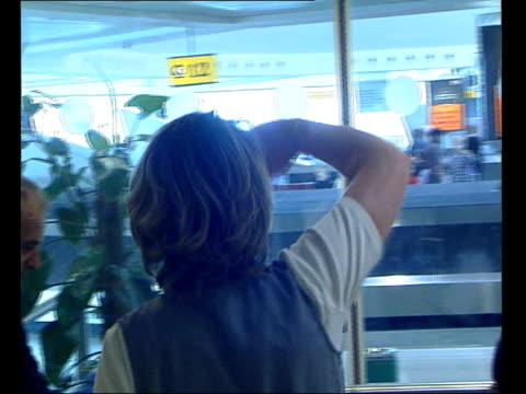 james brown profile itn england london heathrow airport brief shots of people about in airport terminal james brown towards with others putting on... - sunglasses stock videos & royalty-free footage