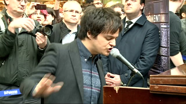 jamie cullum performs live at king's cross st pancras station; england: london: king's cross st pancras station: int jamie cullum performing at... - jamie cullum stock videos & royalty-free footage