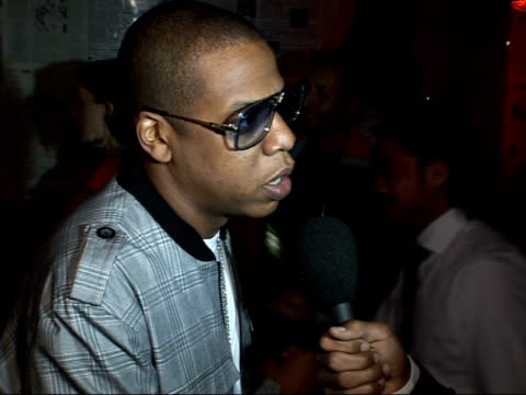 jayz's o2 wireless afterparty arrivals jayz being interviewed sot on his performance at glastonbury and how he'd like to return on boosting the sales... - performing arts event stock videos & royalty-free footage