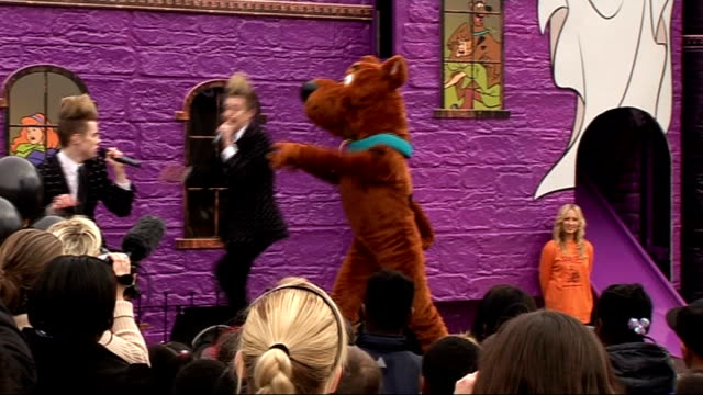 jedward perform at battersea dogs cats home for scoobydoo launch jedward singing song 'ghostbusters' and scooby doo dancing sot - jedward stock videos and b-roll footage