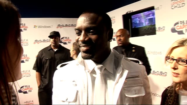 jingle bell ball at 02 arena: backstage interviews; akon talking to press akon interview sot - on his outfit / not too familiar with uk artists but... - akon singer stock videos & royalty-free footage