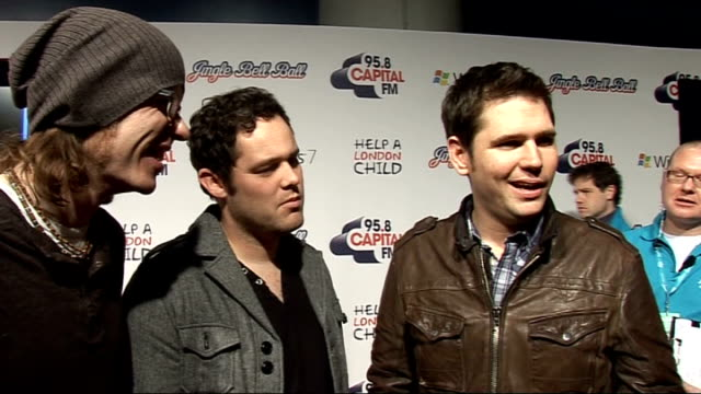vídeos de stock, filmes e b-roll de jingle bell ball at 02 arena backstage interviews scouting for girls interview sot on who they want to win x factor / have written lots of christmas... - trepadeira