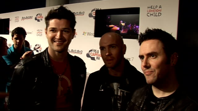 jingle bell ball at 02 arena backstage interviews the script interview talking to press the script interview sot on their success in united states /... - the black eyed peas band stock videos and b-roll footage