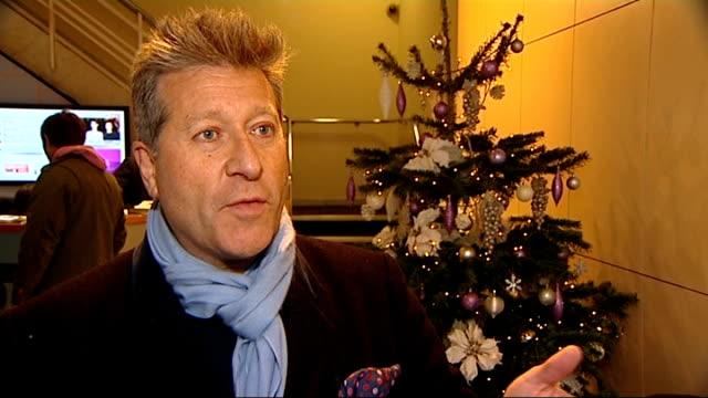 john travolta and olivia newton john charity album england london int neil fox interview sot we love cheesy records - olivia newton john stock videos & royalty-free footage
