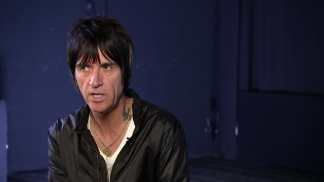 Johnny Marr interview ENGLAND London ICA Reporter asking question SOT Johnny Marr interview SOT re music and politics Thatcher Morrissey Manchester...