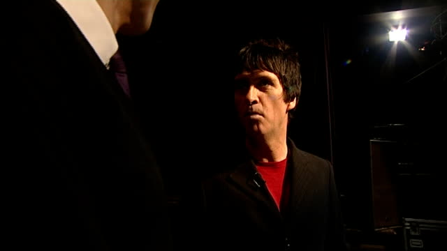 johnny marr to release solo album ext general view of the ritz nightclub back view marr and reporter on stage stage lights marr interview with... - ジョニー マー点の映像素材/bロール