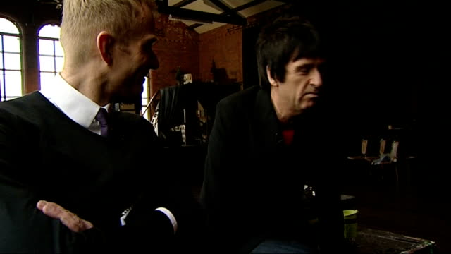 johnny marr to release solo album marr interview with reporter in shot sot - アルバムのタイトル点の映像素材/bロール