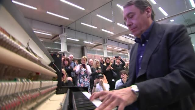 jools holland at st pancras station; jools holland finishes to applause and addresses crowd sot / more of jools holland playing and being recorded by... - jools holland stock-videos und b-roll-filmmaterial