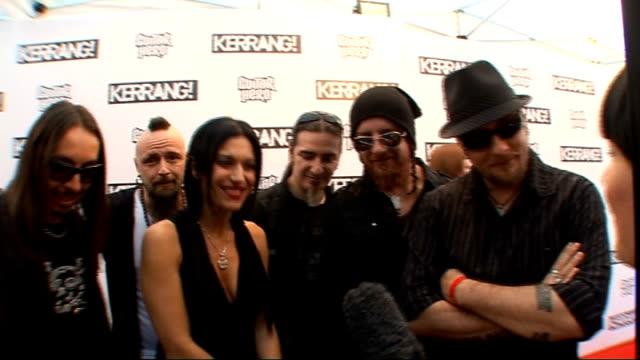 vídeos de stock e filmes b-roll de kerrang awards 2009 interviews and general views *** some members of italian rock bank lacuna coil posing for photocall american heavy metal band... - 2009