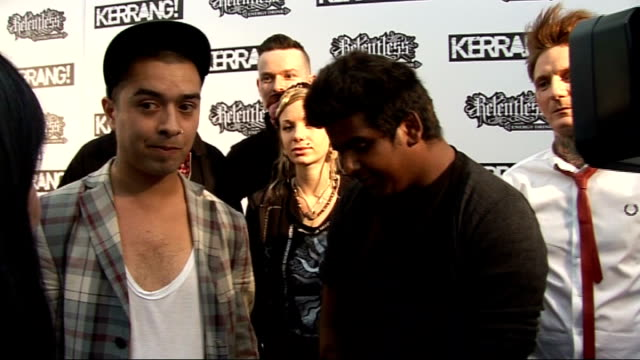 Kerrang Awards 2010 interviews pre and postceremony ENGLAND London PHOTOGRAPHY *** Kerrang backdrop / Unidentified couple posing for press King Blues...