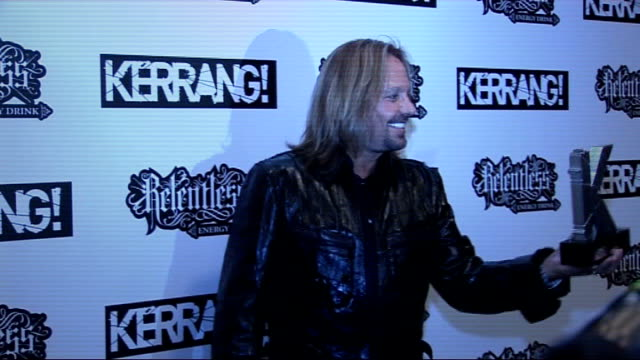 kerrang awards 2010 interviews pre and postceremony vince neil posing with award vince neil speaking to press sot on getting into kerrang hall of... - vince neil stock videos and b-roll footage