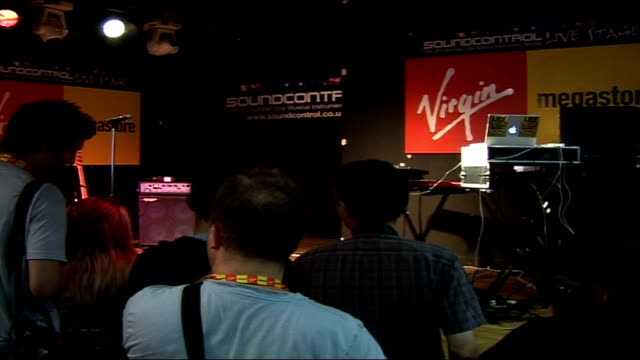 lily allen promotional appearance; england: london: virgin megastore: int crowd gathered at store to see lily allen / stage / lily allen flyers /... - virgin megastore点の映像素材/bロール