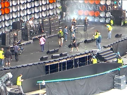 live earth concert: preview; england: london: wembley stadium: ext stage technicians and roadies setting up equipment on stage in preparation for... - wembley stadium stock videos & royalty-free footage