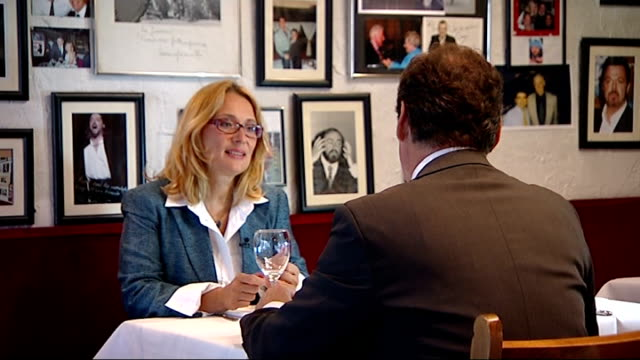 luciano pavarotti's widow; england: london: int set-up shots of reporter sitting in restaurant with pavarotti's widow, nicoletta mantovani-pavarotti... - widow stock videos & royalty-free footage