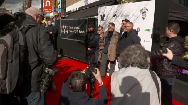 madness honoured on uk's music walk of fame; england: london: camden town: ext **beware flash photography / beware bad language** close shots of... - suggs musician stock videos & royalty-free footage