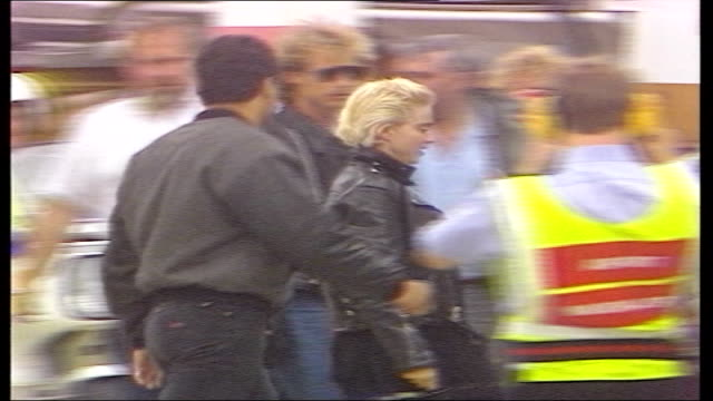 madonna british tour:; england: yorkshire: leeds airport: ext madonna and bodyguards down steps from plane l-r across tarmac madonna and bodyguards... - fan enthusiast stock videos & royalty-free footage
