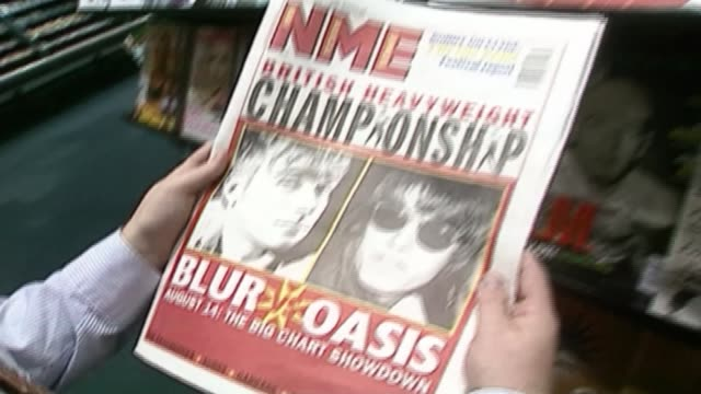 music magazine nme to end print version t06071525 / 672015 london int copy of nme taken from shelf in newsagents nme magazine on shelf - 雑誌点の映像素材/bロール