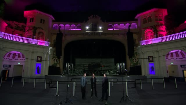 'massive attack' new tour highlights plight of syrian refugees; photographer giles duley and massive attack's robert del naja standing chatting with... - krishnan guru murthy stock videos & royalty-free footage