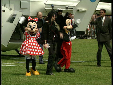 michael jackson arrives in uk and visits children's hospital england london haggeston park michael jackson by helicopter with mickey mouse and minnie... - helicopter stock videos & royalty-free footage