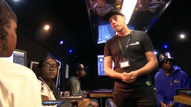 stockvideo's en b-roll-footage met mobile music studio teaching teenagers to write and perform music england london hackney int unidentified man speaking sot wide shot gazebo outside... - gazebo
