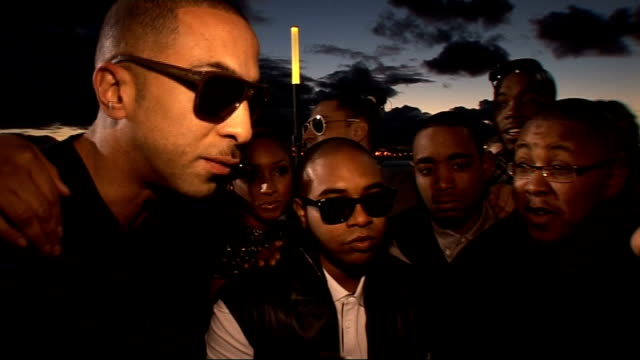 mobo awards 2010 celebrity interviews members of roll deep arriving and speaking to media on red carpet members of roll deep interviewed sot on... - commercial event stock videos & royalty-free footage