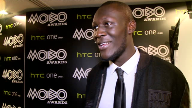 mobo awards 2014 red carpet arrivals burke interview sot on life coaching / stormzy backstage and interview sot on being at the mobos / on winning... - stormzy stock videos and b-roll footage