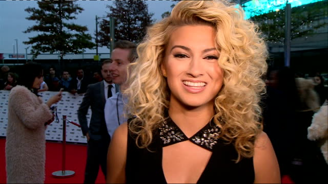 mobo awards 2014 red carpet arrivals england london wembley arena photography *** tori kelly on red carpet and interview sot on performing at mobos /... - wembley arena stock videos and b-roll footage