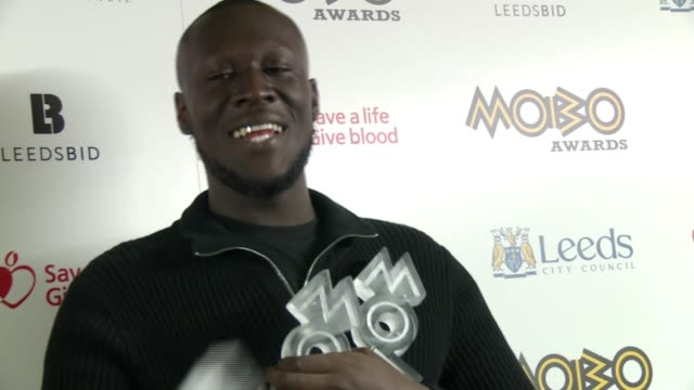 MOBO Awards 2017 Stormzy wins three awards **BEWARE Stormzy posing with his three MOBO Awards and speaking to press SOT I love Leeds do you want to...
