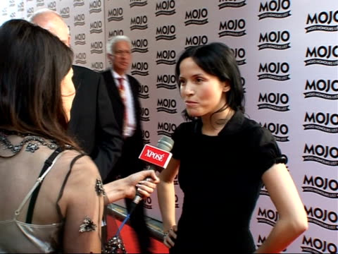 mojo awards 2007 ceremony celebrity photocalls / interviews andrea corr speaking to press and interview sot presenting an award strange without... - アルバムのタイトル点の映像素材/bロール