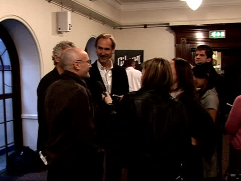 mojo awards 2008 ceremony: celebrity photocalls and interviews; mike rutherford, phil collins and tony banks posing with mojo lifetime achievement... - mike rutherford stock videos & royalty-free footage